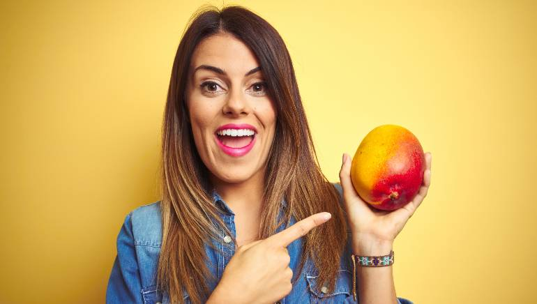 From reducing acne to glowing skin, this is what using mango on your face can do for you